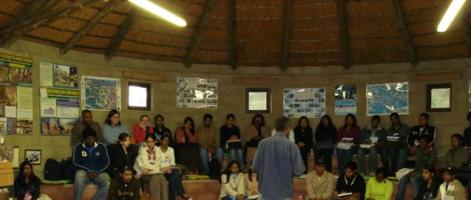 The interior of the education boma with a visiting group